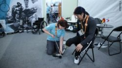 Photo: An Ottobock employee fitting a leg prostheses of an athlete during Winter Paralympics 2018; Copyright: N. Jarrassé 2018