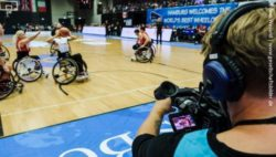 Photo: A camera man filming a game of the wheelchair basketball championship 2018 in Hamburg; Copyright: Andi Weiland | www.gesellschaftsbilder.de