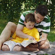 Photo: Boy learning with dad