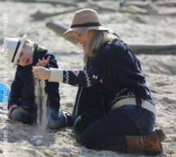 Photo: Marcella Becker and her son play with sand