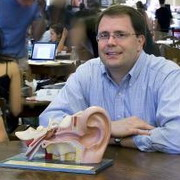 Photo: Researcher and ear model