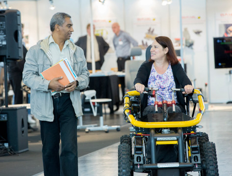 Photo: Woman with off road wheelchair © Messe Düsseldorf