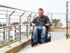 Phot: Man in an electric wheelchair