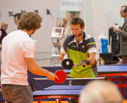 Photo: Table tennis player with a hand prosthesis