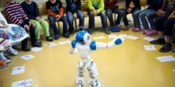Photo: Robot in the middle of a chair circle; Copyright: Avatarion