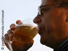 Photo: An older man drinking beer