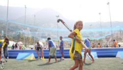 Photo: young Brazilian with hockey stick