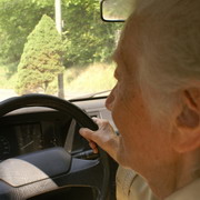 Photo: Elderly woman drives a car