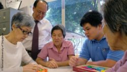 Photo: Professor Ng Tze Pin is watching three old ladys playing a game; Copyright: National University of Singapore