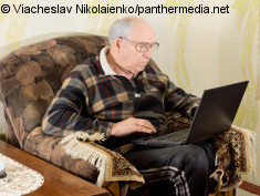 Photo: Elderly man using a laptop