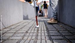Photo: White cane used by a blind person; Copyright: Andi Weiland | Gesellschaftsbilder.de