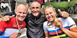 Photo: Christiane Reppe with a Gold medal and two team members; Copyright: private