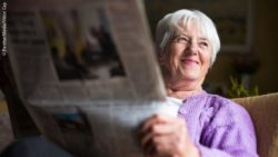 Photo: Senior female reading the newspaper; Copyright: PantherMedia/Viktor Cap