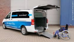Photo: A Mercedes Car with a ramp and a blue wheelchair behind it; Copyright: AMF Bruns GmbH u. Co KG