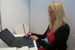 "Photo: Conny Rippe at her ""working space"" with a braille line at her Laptop; Copyright: beta-web/Schlüter"