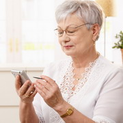Photo: Elderly woman with smartphone