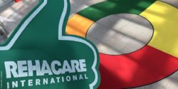 "Photo: Green foam thumb with the inscription ""REHACARE International"" in the entrance area north; Copyright: beta-web 