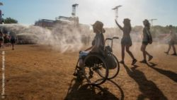 Photo: Wheelchair user at a music festival; Copyright: Timo Hermann - thermann.de