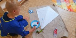 Photo: Boy painting a kite; Copyright: mission:lebenshaus gGmbH