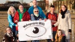 Photo: Members of the cooperative on the building lot; Copyright: Wohnprojekt BliSS