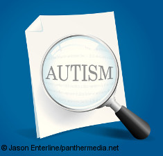 "Photo: Magnifying glass over the word ""autism"" on a paper"