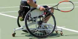 Photo: Man in a sport wheelchair holding a tennis racket; Copyright: panthermedia.net/Nicholas Rjabow