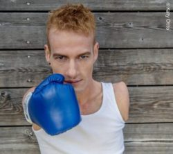 Photo: Janis McDavid with a blue boxing glove; Copyright: Katy Otto