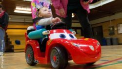Photo: Toddler uses a Go Baby Go modified toy car; Copyright: Oregon State University