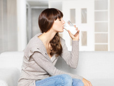 Photo: Woman drinking a glass of milk