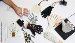 Photo: Table with several prototypes of the Lorm Glove
