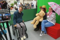 Photo: People in the photo box at REHACARE; Copyright: beta-web/Schlüter