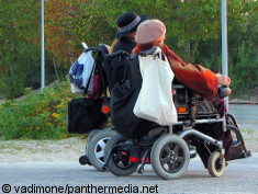 Photo: Two women in their wheelchairs