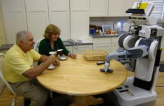 Photo: Robot with old people at the table