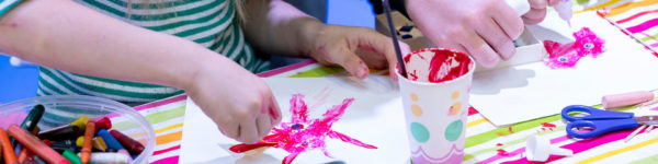Photo: Children's hands paint using finger paints
