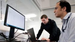 Photo: Researchers in front of a computer using eye tracking technology; Copyright: Birmingham City University