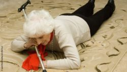 Photo: Elderly woman laying on the ground after a fall; Copyright: panthermedia.net/bichon