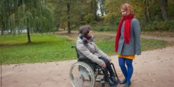 Photo: Wheelchair user and her Personal Assistant; © panthermedia.net/Natalia Romashova