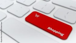 "Photo: Laptop keyboard with red key which says ""Shopping""; Copyright: panthermedia.net/seenivas"