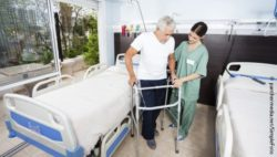 Photo: Nurse helping an elderly man using his walker; Copyright: panthermedia.net/SimpleFoto