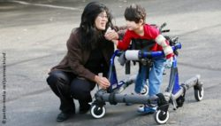 Photo: Woman and her son who uses a walking aid; Copyright: panthermedia.net/jarenwicklund