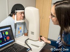 Photo: Man with Down syndrome during eye examination