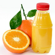 Photo: Bottle of Orange Juice and Orange Fruits