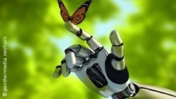 Image: A butterfly sitting on a robot's hand; Copyright: panthermedia.net/lurii