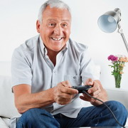 Photo: Man plays video game