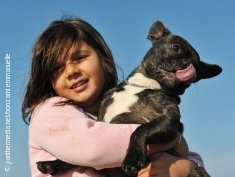 Photo: Girl with a dog on her arms