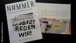 Photo: Two magazines lying on a black background; Copyright: beta-web/Lormis