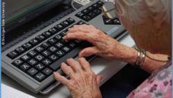 Photo: Elderly woman using a computer; Copyright: Michigan State University