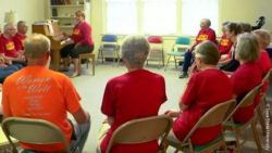 Photo: Elizabeth Stegemöller leads a singing group for people with Parkinson's disease; Copyright: Iowa State University
