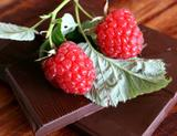 Photo: Raspberries and pieces of chocolate