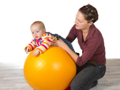 Photo: Baby lying on a gymnastic ball